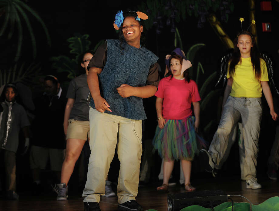 Seventh grader Carolyn Smith stars as Baloo the bear in Disney's Jungle Book KIDS stage production at Roosevelt School in Bridgeport, Conn., on Wednesday, June 12, 2012. Photo: Brian A. Pounds / Connecticut Post