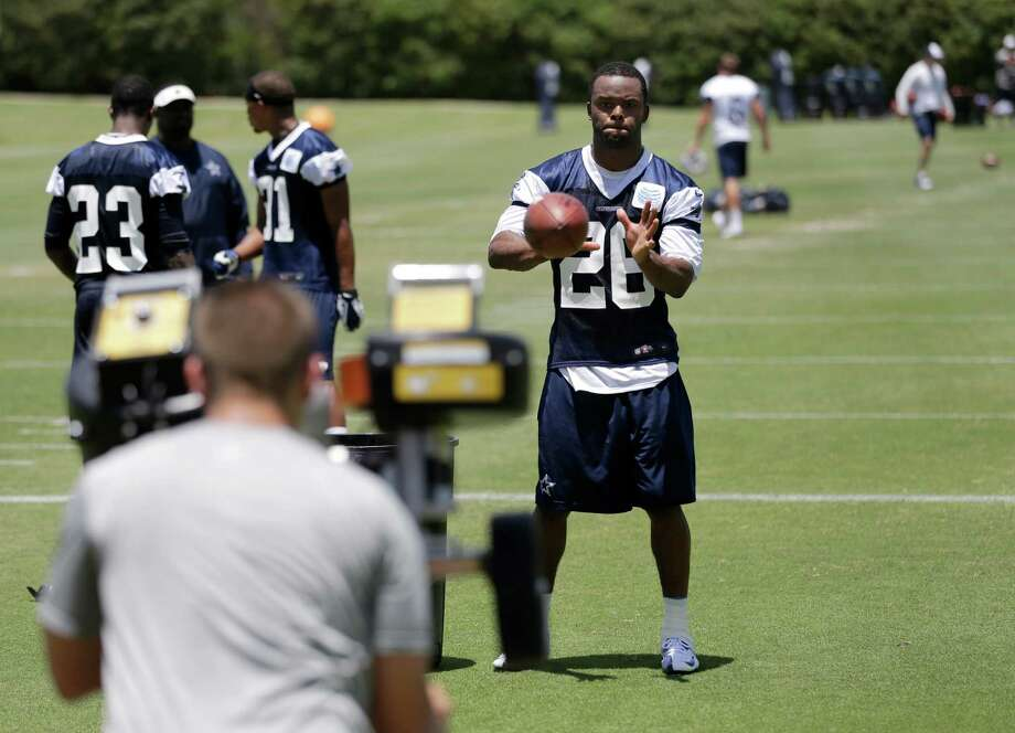 Dallas Cowboys safety Will Allen (26) grabs passes as he participates in defensive drills during their NFL football minicamp on Tuesday, June 11, 2013, in Irving, Texas. (AP Photo/Tony Gutierrez) Photo: Tony Gutierrez, Associated Press / AP