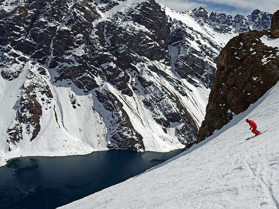 A pristine winter panorama of peaks that soar from the shores of Laguna del Inca greets visitors at the Portillo Ski Resort in Chile. Photo: Bill Fink, Special To The Chronicle