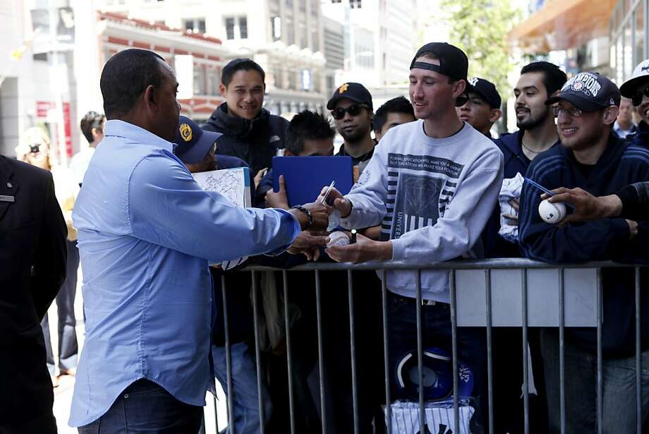 Yankees bench coach Tony Peña greets fans outside the St. Regis Hotel in San Francisco. Many waited hours to see the team boarding the bus for Oakland. Photo: Katie Meek, The Chronicle