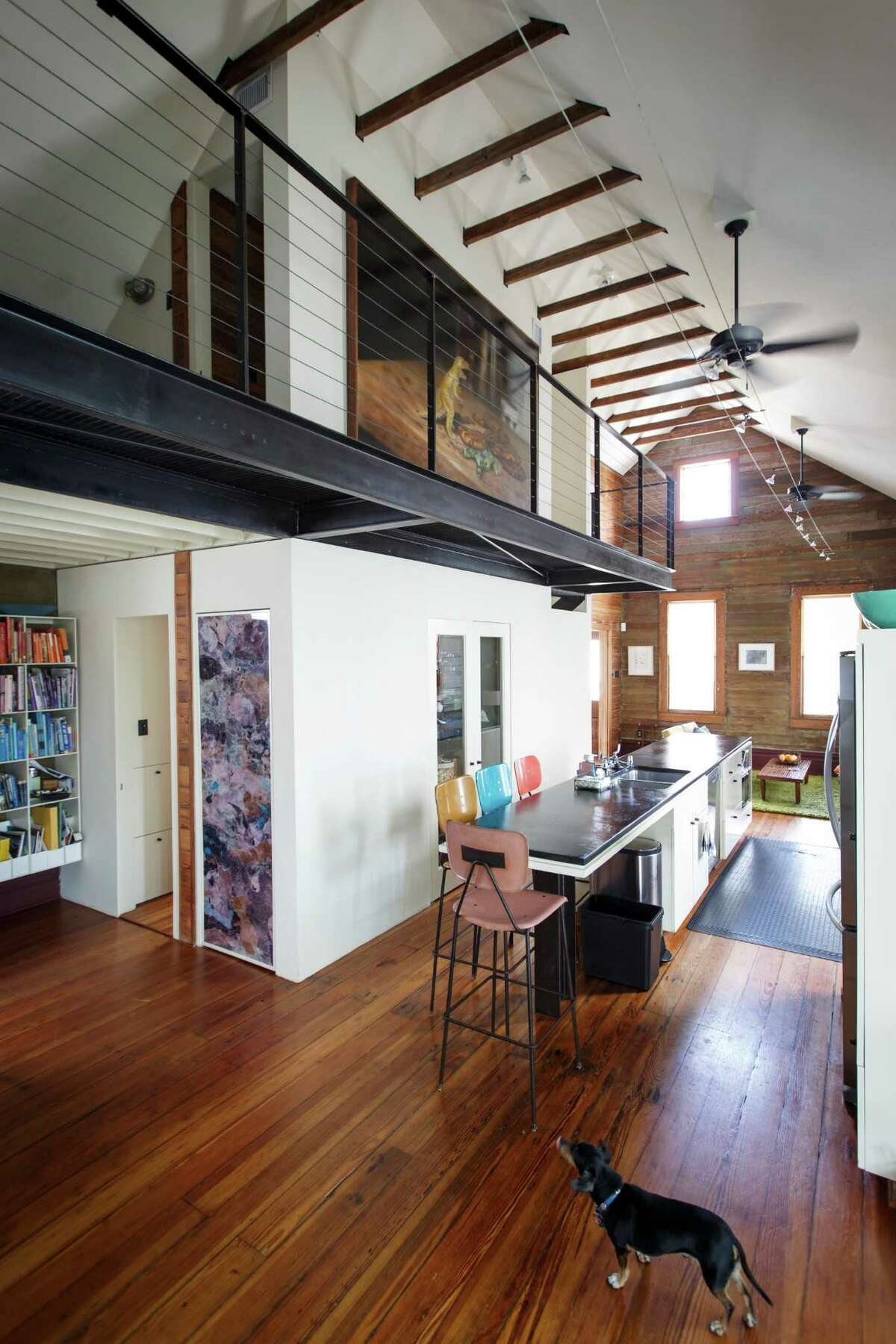 A renovation of the original 1885 house that was completed in 2000 included opening up the roof to create space for a second-floor master bedroom and office reached via catwalk. ( Michael Paulsen / Houston Chronicle )