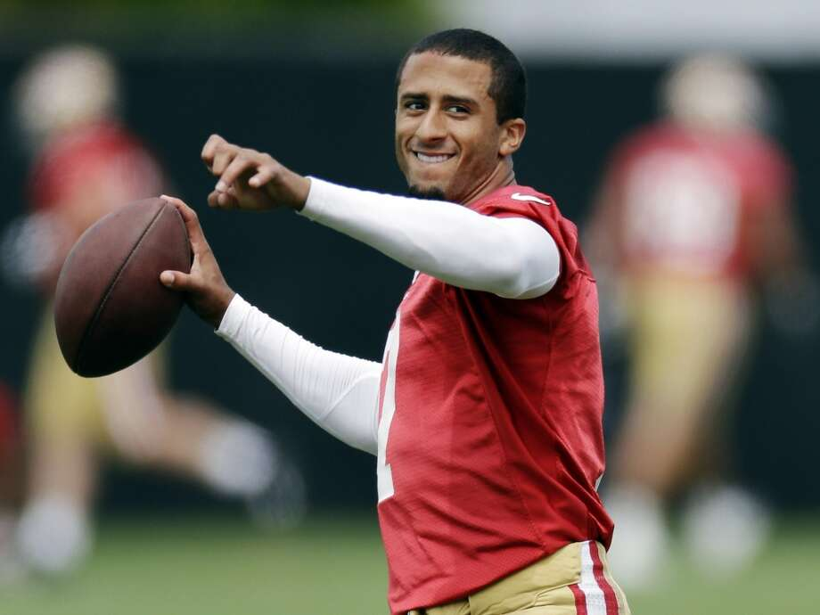 San Francisco 49ers quarterback Colin Kaepernick (7) smiles as he throws during practice at the team's NFL football training facility in Santa Clara, Calif., Tuesday, June 11, 2013. (AP Photo/Marcio Jose Sanchez)