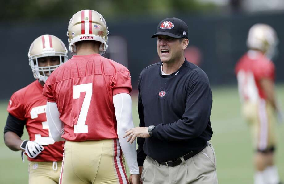 San Francisco 49ers head coach Jim Harbaugh during practice at the team's NFL football training facility with quarterback Colin Kaepernick (7) in Santa Clara, Calif., Tuesday, June 11, 2013. (AP Photo/Marcio Jose Sanchez)