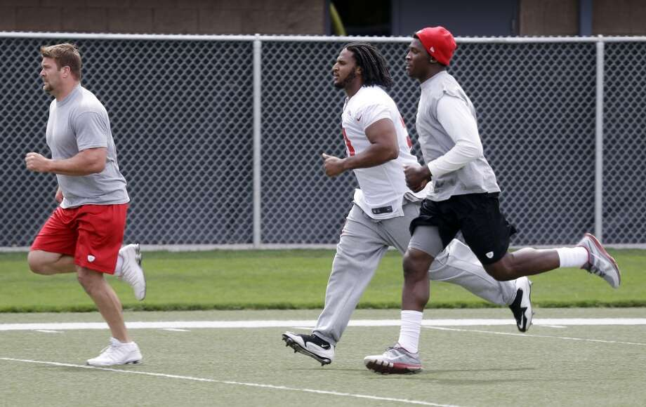 San Francisco 49ers defensive end Justin Smith, left, defensive tackle Ray McDonald, center, and defensive end Aldon Smith (99) run during practice at the team's NFL football training facility in Santa Clara, Calif., Tuesday, June 11, 2013. (AP Photo/Marcio Jose Sanchez)
