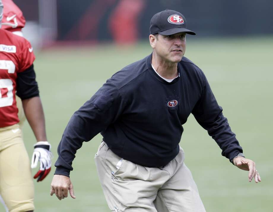 San Francisco 49ers head coach Jim Harbaugh during practice at the team's NFL football training facility in Santa Clara, Calif., Tuesday, June 11, 2013. (AP Photo/Marcio Jose Sanchez)