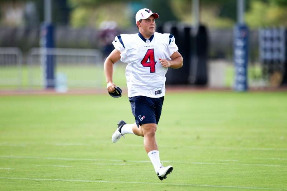 Kicker Randy Bullock runs across the field. Photo: Brett Coomer, Chronicle