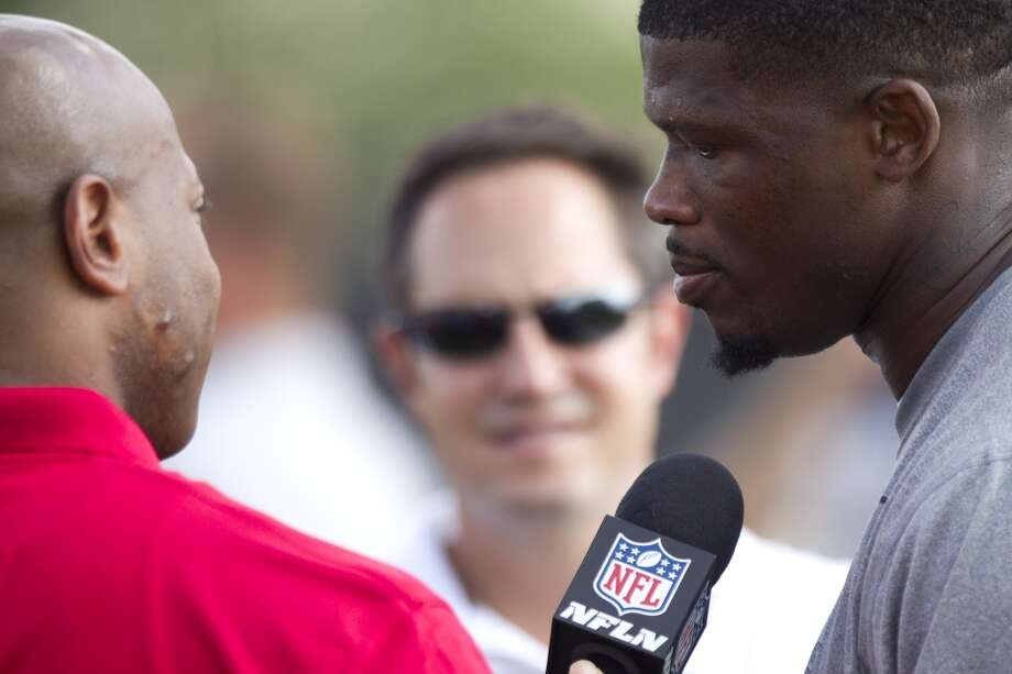 Wide receiver Andre Johnson, right, does an interview after his workout. Photo: Brett Coomer, Chronicle