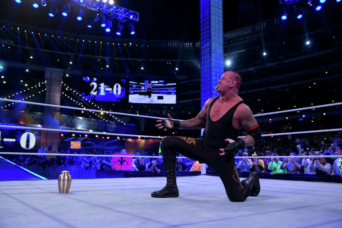 The Undertaker's real name is Mark William Calaway, and he attended Waltrip High School.