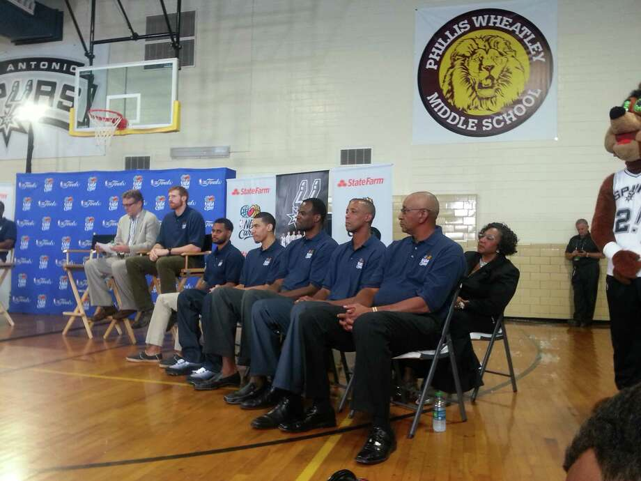 Former and current Spurs Matt Bonner, Patty Mills, Danny Green, David Robinson, Sean Elliott and George Gervin at Wheatley Middle School. Photo: Nora Lopez/Express-News