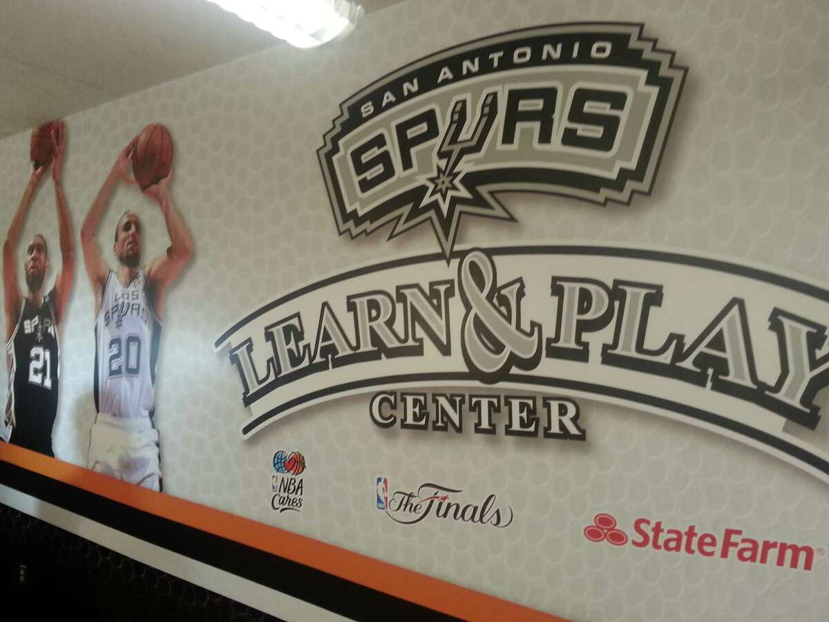 The NBA Cares Learn & Play center features lots of photos of Spurs players.