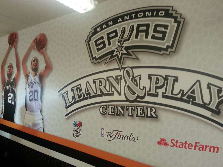 The NBA Cares Learn & Play center features lots of photos of Spurs players. Photo: Nora Lopez/Express-News