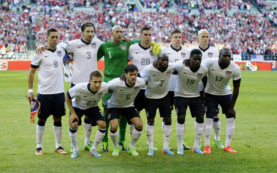 USA's national soccer team poses for the traditional team photo prior to a World Cup qualifier soccer match against Panama, Tuesday, June 11, 2013, in Seattle. Pictured are (front row, left to right) Fabian Johnson, Brad Evans, DaMarcus Beasley, Eddie Johnson, and Jozy Altidore. Back row, left to right, are Clint Dempsey, Omar Gonzalez, goalkeeper Tim Howard, Geoff Cameron, Matt Besler, and Michael Bradley. Photo: Ted S. Warren, AP / AP