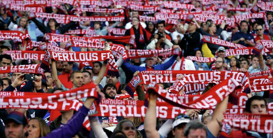 "USA supporters raise soccer scarves with the phrase ""Through The Perilous Fight"" on them at the start of a World Cup qualifier soccer match against Panama, Tuesday, June 11, 2013, in Seattle. Photo: Ted S. Warren, AP / AP"