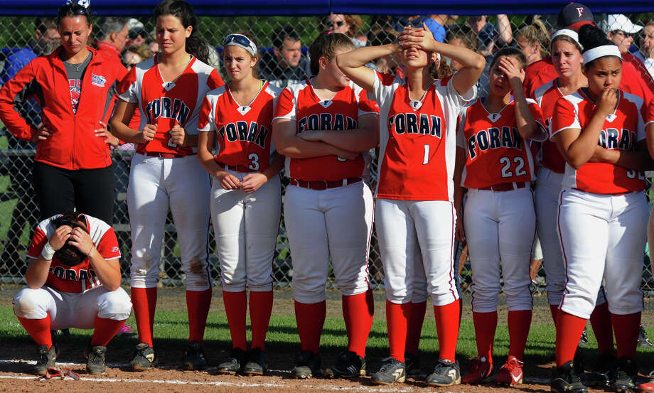 Foran players are stunned after an upset by Masuk after Class L softball finals action in West Haven, Conn. on Wednesday June 12, 2013. Masuk beat Foran 3-2. Photo: Christian Abraham / Connecticut Post