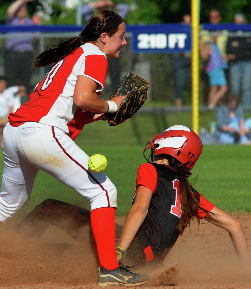 Foran's Marissa Bruno bobbles the toss to her as Masuk's Lauren Middlesmass gets to second safely, during Class L softball finals action in West Haven, Conn. on Wednesday June 12, 2013. Photo: Christian Abraham / Connecticut Post