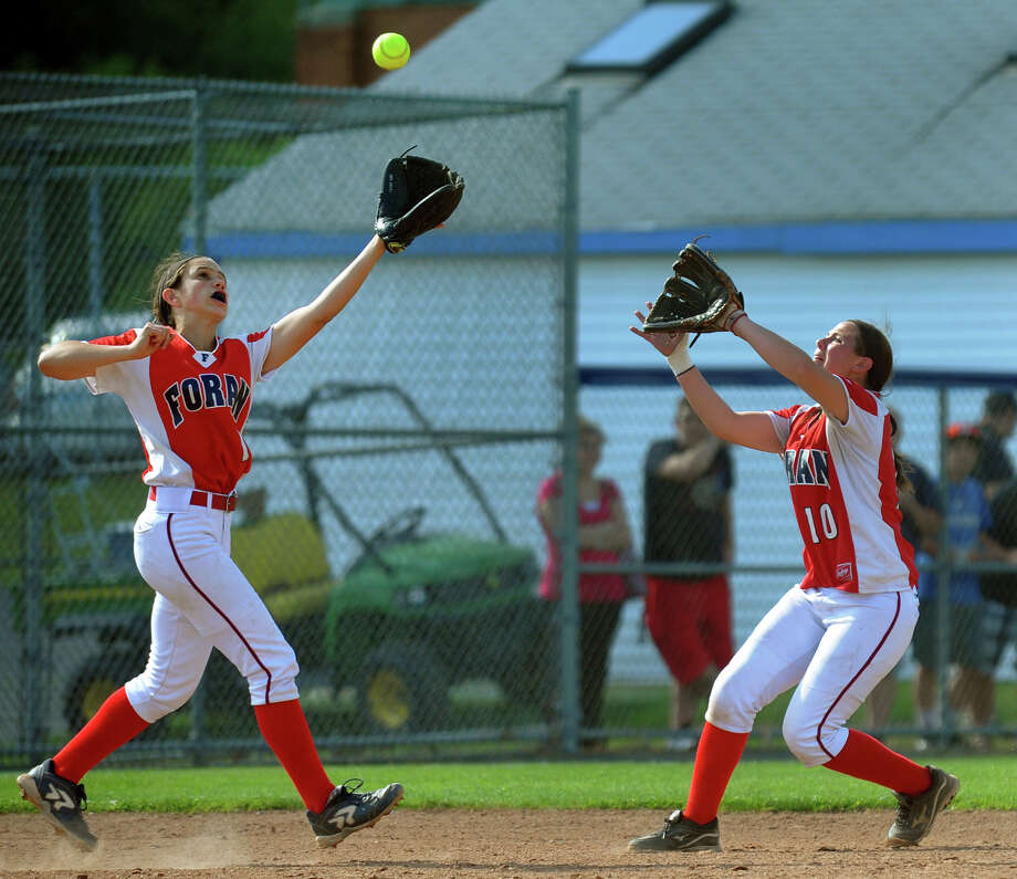 Foran's Jenna Zacarelli, left, and Marissa Bruno both reach to catch a Masuk hit, during Class L softball finals action in West Haven, Conn. on Wednesday June 12, 2013. Zacarelli made the catch. Photo: Christian Abraham / Connecticut Post