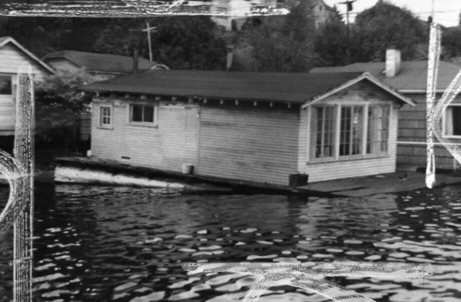 A problem with houseboats then: They tipped, when the water level was low. This photo shows a 1950s houseboat heading into Lake Union. (Photo: Copyright MOHAI, Seattle Post-Intelligencer collection, 2000.107.2).  Photo: -