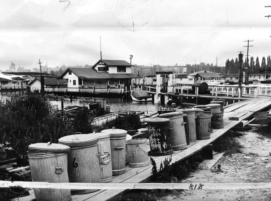"Houseboats began to dwindle in the '50s, to make way for urban renewal. Officials and ""uplanders"" also complained of sewage and trash. The caption of this 1952 Portage Bay photo referred to the ""nuisance"" of ""ashcans on the boardwalks."" 