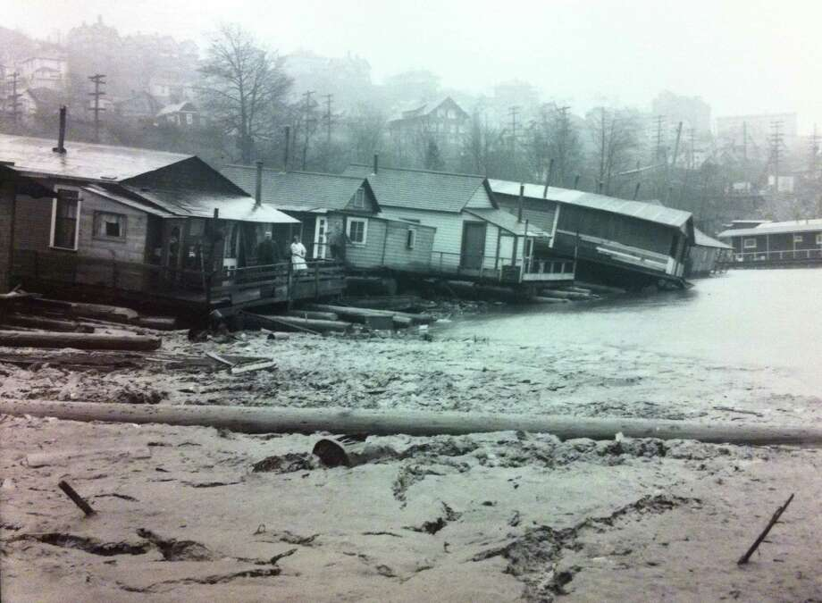 Lake Washington houseboats took a hit in 1916, when the lake was lowered nine feet, to make it level with Lake Union. That was done to build the Lake Washington Ship Canal in 1917. The lowering caused many houseboats to tip, pictured.     (Photo: Webster & Stevens/copyright MOHAI, 1983.10.9810.1).  Photo: -