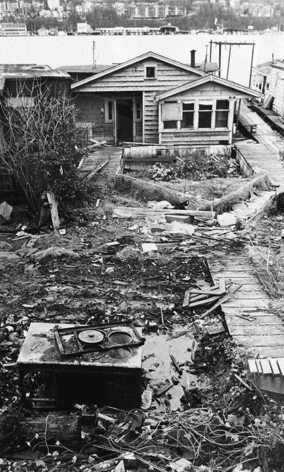 "The '70s saw many evictions, over rising moorage rates and increased development. The caption on this 1971 photo said these houseboats had been ""left to rot,"" after becoming ""victims of (a) high-rise next door."" (Photo: Tim Eagan, copyright MOHAI, Seattle Post-Intelligencer collection, 2000.107.11).  Photo: -"