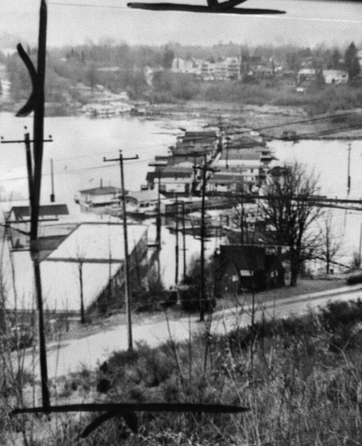 The 520 bridge, completed in 1963, led to the razing of many houseboats, including these Portage Bay homes pictured two years earlier. (Photo: copyright MOHAI,  Seattle Post-Intelligencer collection, 2000.107.12). Photo: -