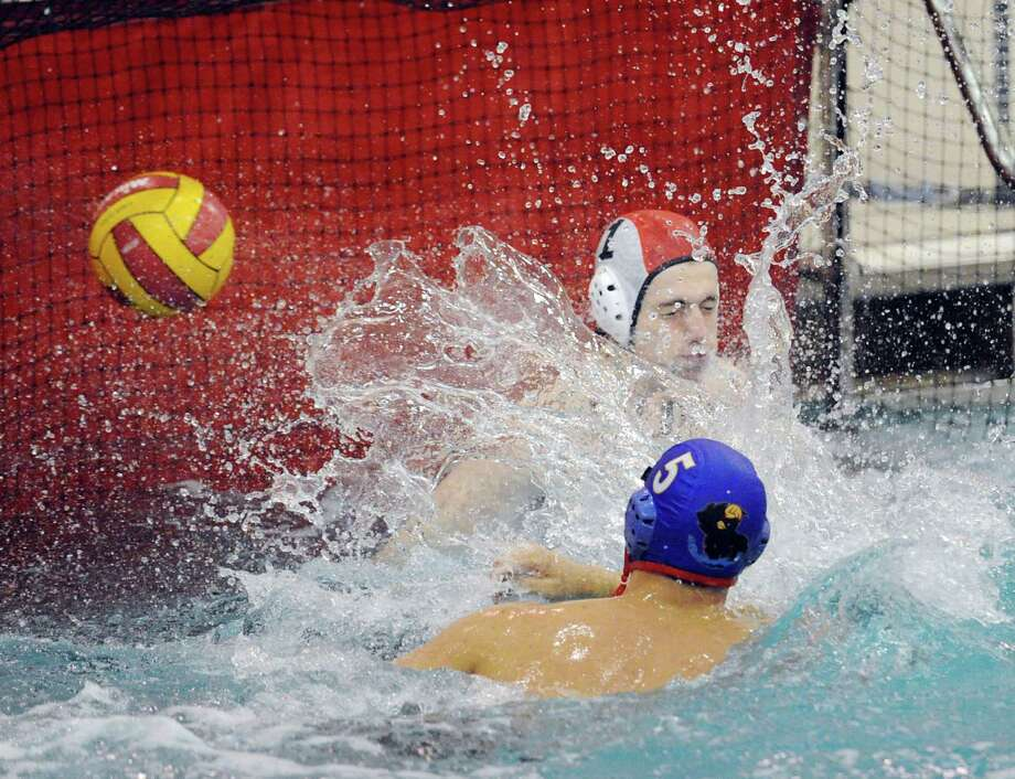 At bottom, Matthew Fraser # 5 of Greenwich scores as Deefield goalie Francesco Franzinetti # 1 misses the block during high school water polo match between Greenwich High School and Deerfield Academy at Greenwich, Saturday afternoon, Oct. 6, 2012. Photo: Bob Luckey / Greenwich Time