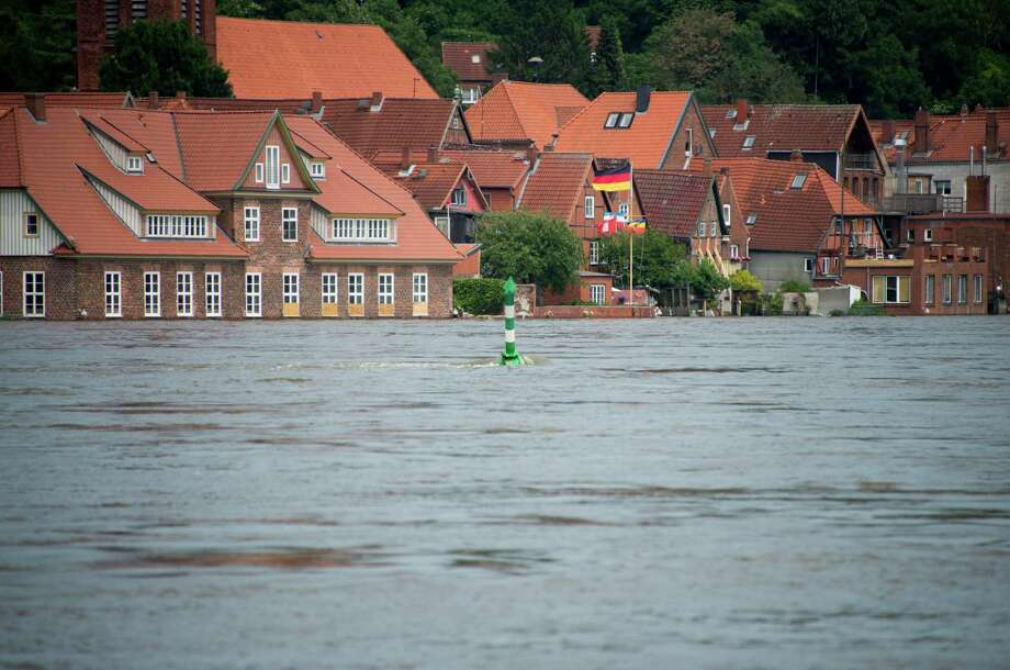 The houses of Lauenburg, northern Germany are pictured on June 12, 2013. Disastrous floods in Germany began to subside after leaving at least 19 people dead in central Europe, as Chancellor Angela Merkel made her fourth visit to the stricken region. AFP PHOTO / JOHANNES EISELEJOHANNES EISELE/AFP/Getty Images Photo: JOHANNES EISELE, AFP/Getty Images / AFP
