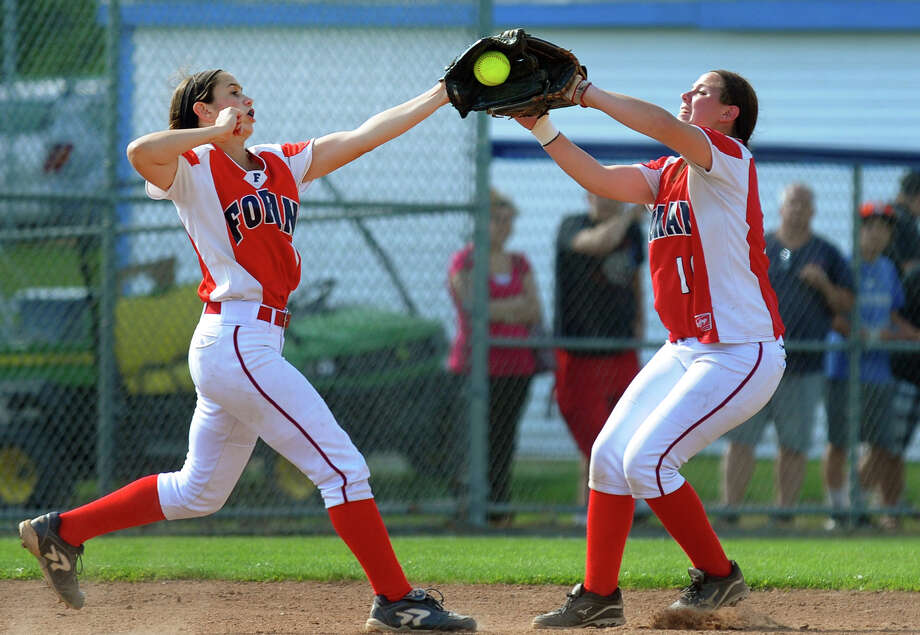 Foran's Jenna Zacarelli, left, catches a Masuk hit, during Class L softball finals action in West Haven, Conn. on Wednesday June 12, 2013. Converging on the ball is teammate Marissa Bruno. Photo: Christian Abraham / Connecticut Post