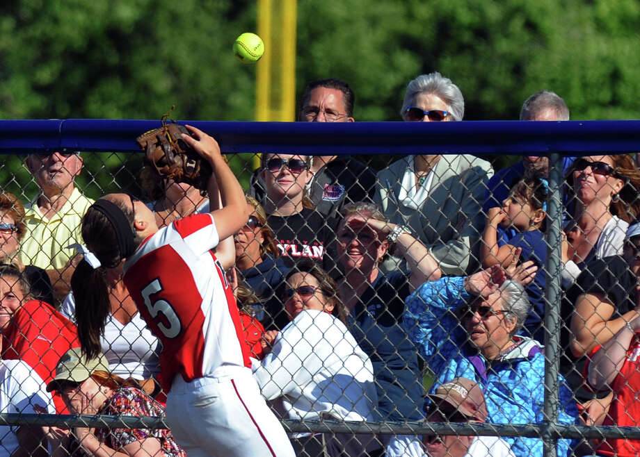 Foran's Jessica Harkness tries to catch a Masuk hit in foul territory, during Class L softball finals action in West Haven, Conn. on Wednesday June 12, 2013. Photo: Christian Abraham / Connecticut Post
