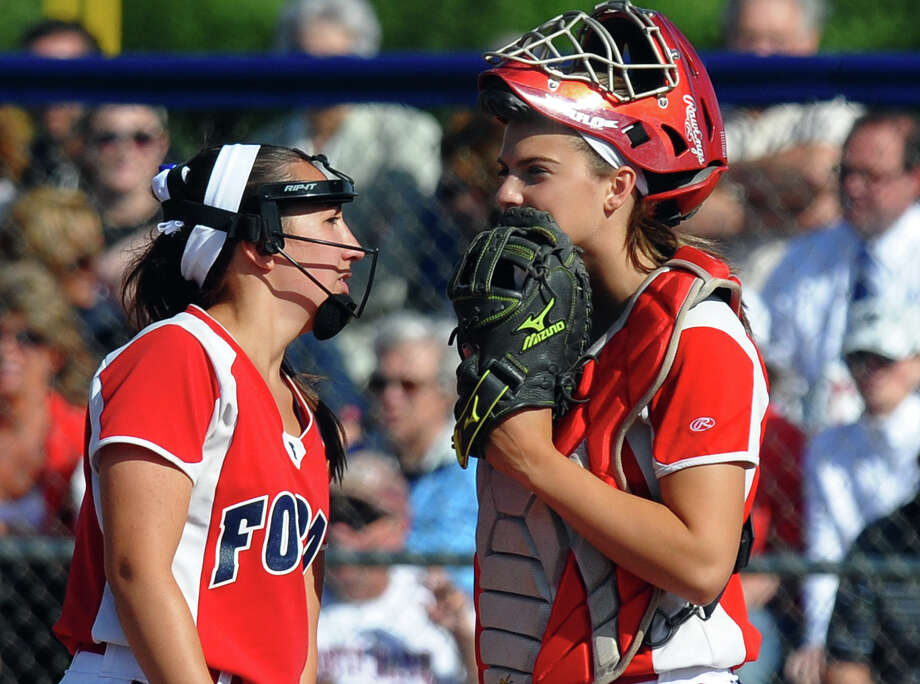 Foran pitcher Jessica Harkness, left, and catcher Danielle Kemp confer with each other on the mound, during Class L softball finals action against Masuk in West Haven, Conn. on Wednesday June 12, 2013. Photo: Christian Abraham / Connecticut Post