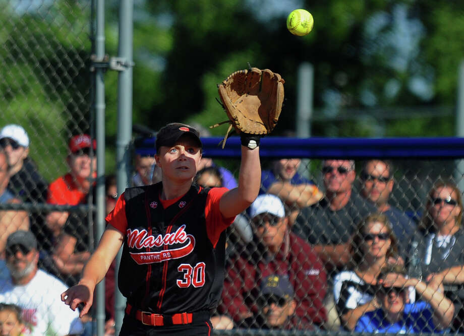Masuk's Melissa Peet gets the ball at first, during Class L softball finals action against Foran in West Haven, Conn. on Wednesday June 12, 2013. Photo: Christian Abraham / Connecticut Post