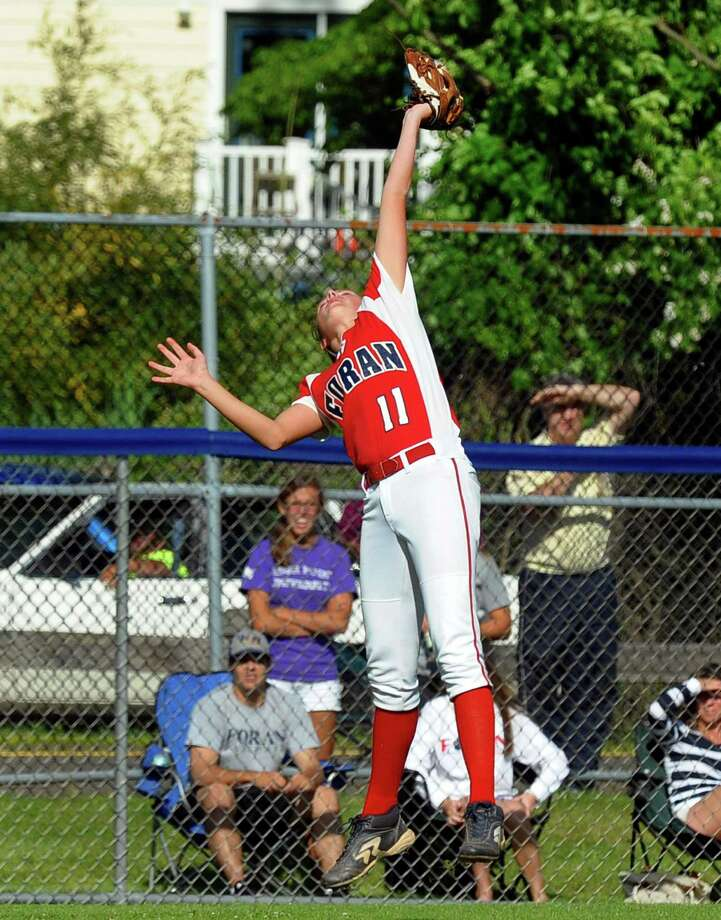 Foran's Fallon Bevino makes a leaping catch in the outfield, during Class L softball finals action against Masuk in West Haven, Conn. on Wednesday June 12, 2013. Photo: Christian Abraham / Connecticut Post