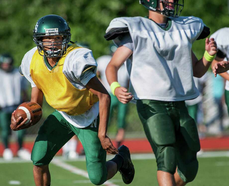 Quarterback Jeremy Linton looks to run the ball during Norwalk high school's annual green and white Spring football game played at Norwalk high school, Norwalk, CT on Wednesday June 12th, 2013. Photo: Mark Conrad / Stamford Advocate Freelance