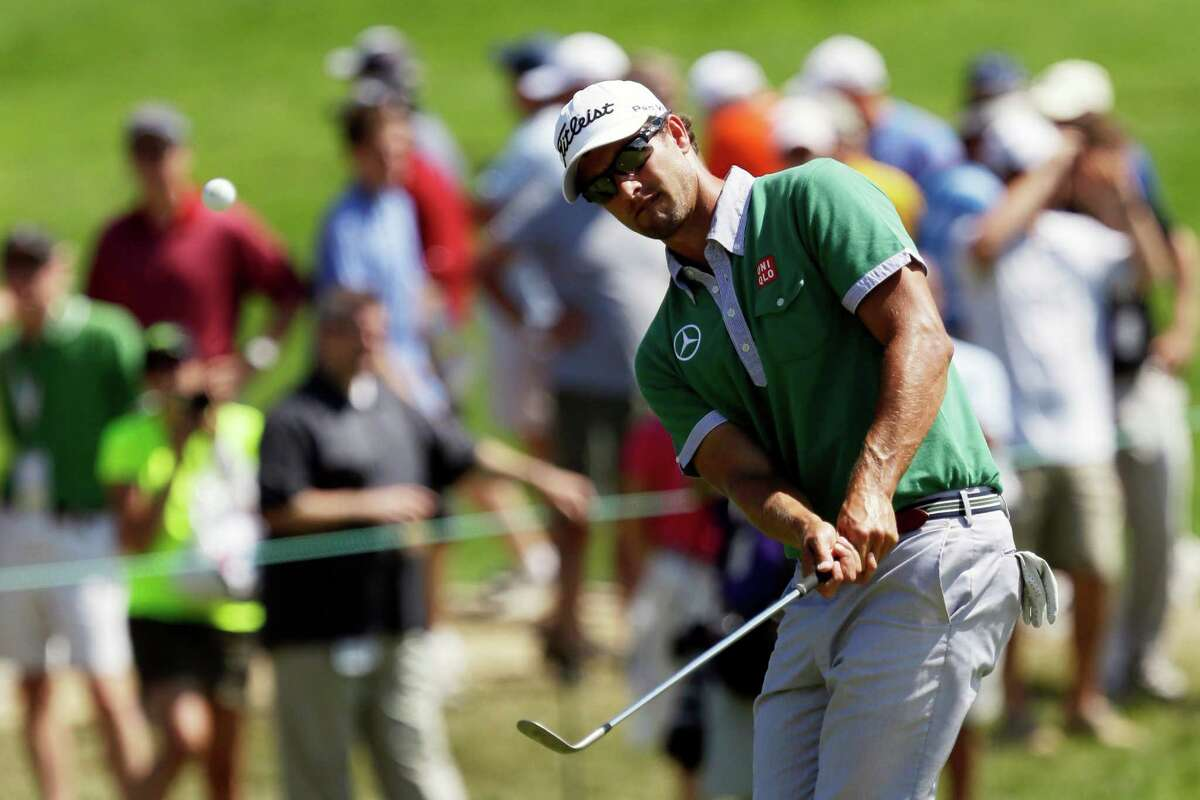 Adam Scott, of Australia, chips onto the fourth green during practice for the U.S. Open golf tournament at Merion Golf Club, Wednesday, June 12, 2013, in Ardmore, Pa. (AP Photo/Gene J. Puskar)