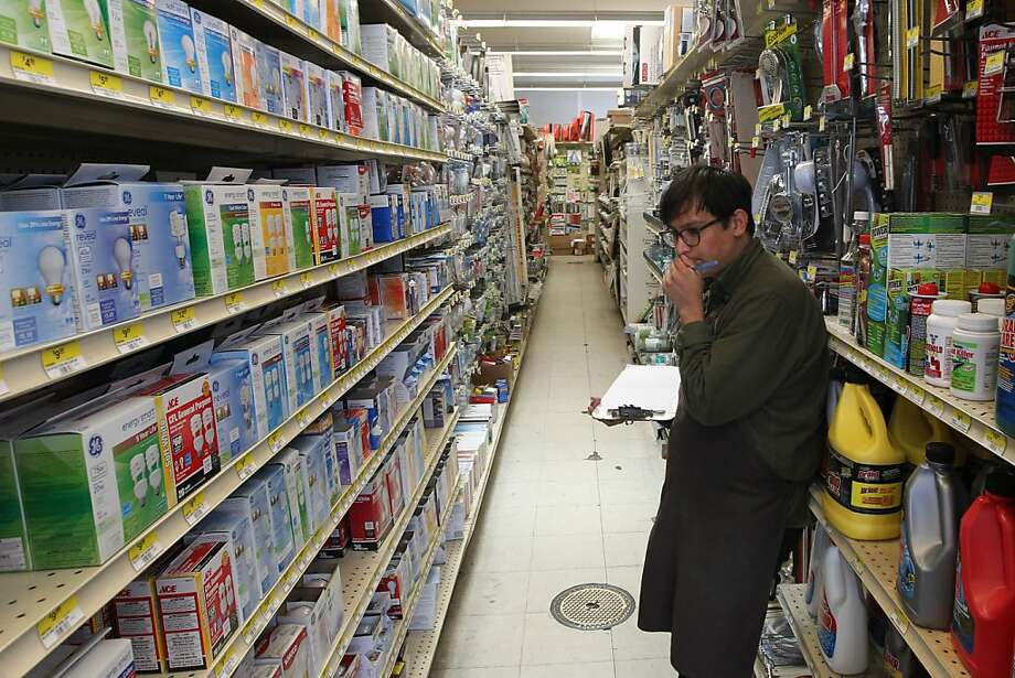 Adrian Saenz, a worker at Brownies Hardware, takes inventory at the Polk Street store. Photo: Lance Iversen, The Chronicle