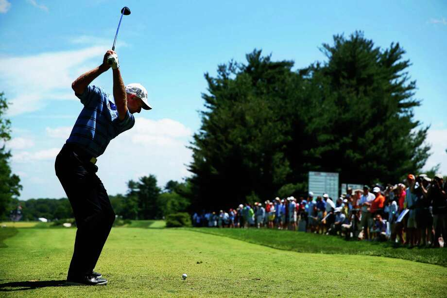 The clear skies that greeted  Jim Furyk and other golfers Wednesday are likely to be a distant memory with heavy rain predicted for today. Photo: Scott Halleran, Staff / 2013 Getty Images