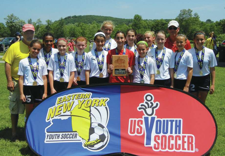 The Alleycats Ocicats won the Eastern New York State Championships State Cup. Players are, from left, Isabella Audette (Ballston Spa), Jennifer Barlett (Albany), Marissa Gordon (Schenectady), Grace Hotaling (Delmar), Sloan Howard (Ballston Spa), Nicoletta Huban (Latham), Jennifer Kirker (Rexford) Julia Laurilliard (Niskayuna), Olivia Piraino (Niskayuna), Sarah Richardson (Malta), Penny Rocchio (Castleton), Sarah Sierzenga (Ballston Spa) and Caitlin Wania (Ballston Spa). Coaches are Skip Dawson, left, and Mark Havis. The team also is coached by Ashley Moore.