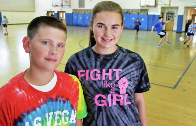 Cohoes Middle School students Danny Buchanan,12, left, and Bryanna Pelkey, 13, at the indoor soccer tournament they organized to raise awareness and donations for the Autism Society at their school in Cohoes, NY, Wednesday June 5, 2013.    (John Carl D'Annibale / Times Union) Photo: John Carl D'Annibale / 00022696A