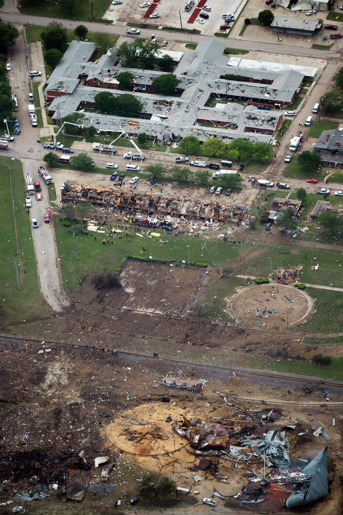 Damage from the explosion of the fertilizer plant in West is seen the day after. The plant is at the bottom, an apartment complex is at center, and a nursing home is at top.