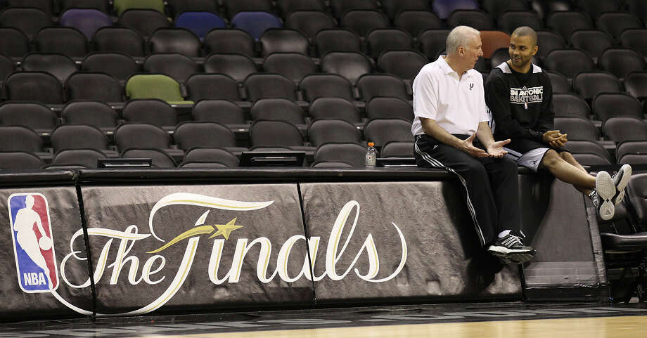 A reader expresses her appreciation for this photo of San Antonio head coach Gregg Popovich and guard Tony Parker. Photo: Kin Man Hui, San Antonio Express-News / ©2013 San Antonio Express-News