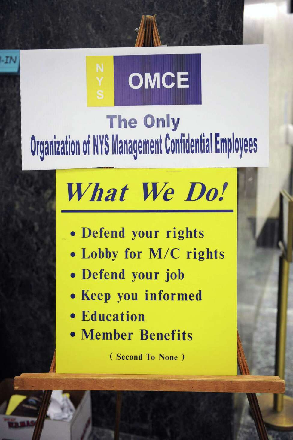 Sign at a demonstration by the Organization of NYS Management Confidential Employees (OMCE) at the Legislative Office Building on Wednesday, June 12, 2013 in Albany, N.Y. The non-unionized state employees have gone years without a raise. (Lori Van Buren / Times Union)