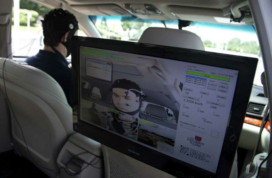 A monitor shows a subject in a research vehicle skull cap during a demonstration in support of a new study on distracted driving, which showed a disengaged brain can lead to an accident.