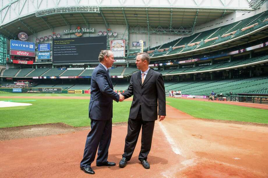 Reid Ryan, right, shakes hands with Houston Astros owner Jim Crane after a press conference where he was announced as the new Astros president at Minute Maid Park on Friday, May 17, 2013, in Houston.  Ryan, the eldest son of Astros pitching great and current Texas Rangers executive Nolan Ryan, is the CEO of Ryan-Sanders, the owner of the Round Rock Express and Corpus Christi Hooks, a pair of successful minor league franchises. Photo: Smiley N. Pool / © 2013  Smiley N. Pool