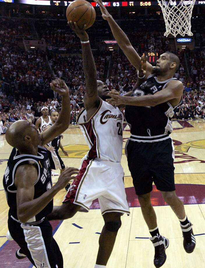 The Spurs' Tim Duncan defends the Cavaliers' LeBron James as Bruce Bowen looks on during second half action of Game 4 in the NBA Finals at the Quicken Loans Arena on June 14, 2007, in Cleveland. The Spurs swept the Cavalier in four games.