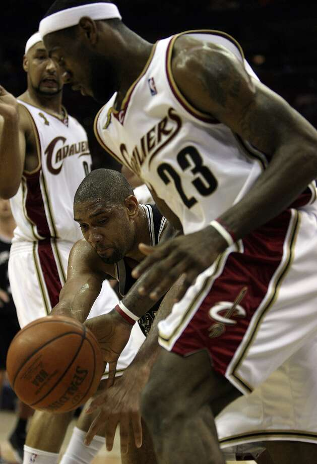Spurs' forward Tim Duncan (21) grabs for the ball against Cavaliers forward LeBron James (23) during second half action of Game 3 in the NBA Finals at the Quicken Loans Arena on June 12, 2007, in Cleveland.