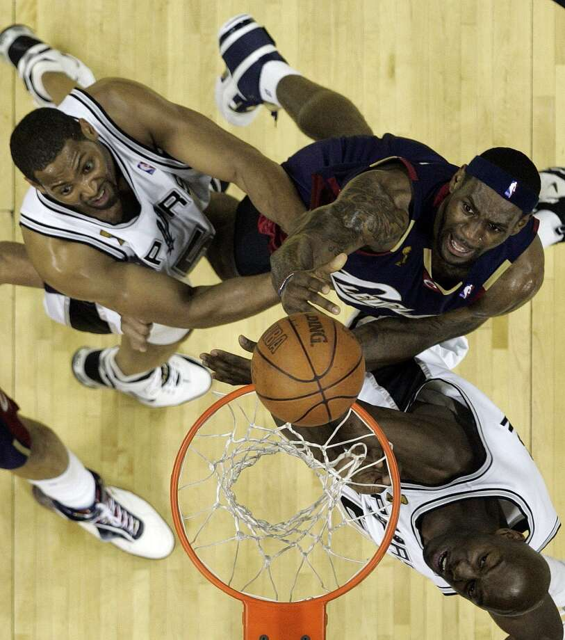 Spurs' center Francisco Elson (16) and forward Robert Horry (5) defend Cavaliers forward LeBron James (23) during second half action of Game 2 in the NBA Finals at the AT&T Center on June 10, 2007.