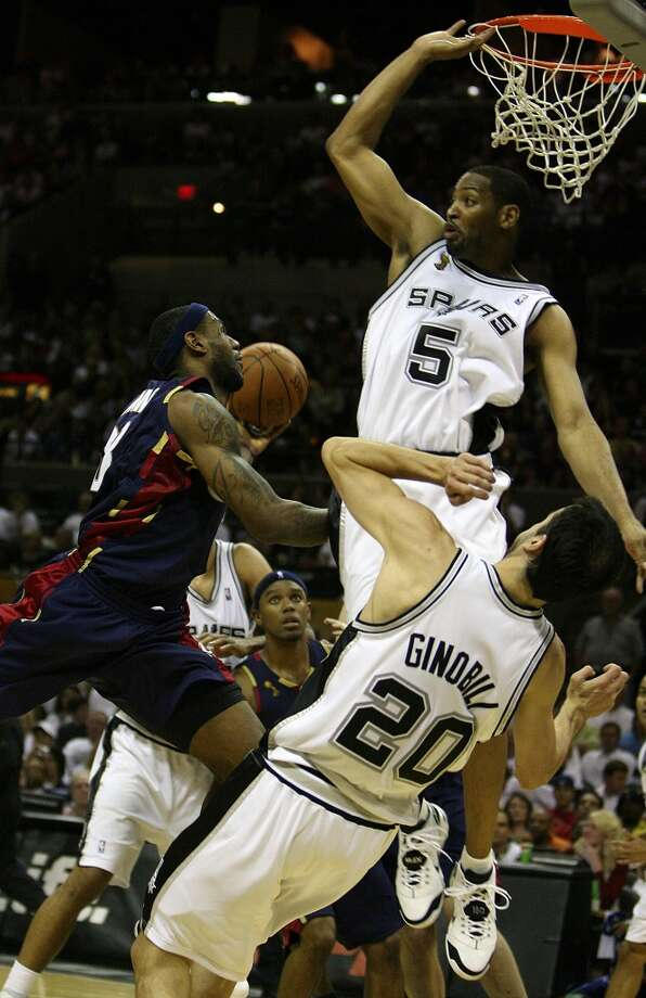Spurs' forward Robert Horry (5) defends the basket against a driving Cavaliers forward LeBron James (23) during first half action in the NBA Finals Game 2 in San Antonio on June 10, 2007.