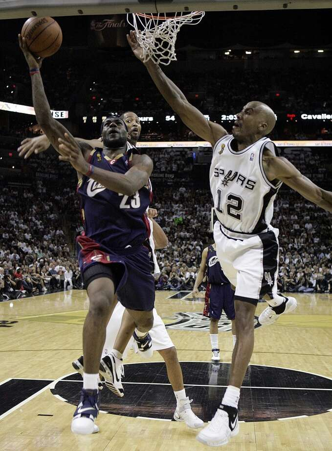 The Spurs' Robert Horry and Bruce Bowen defend the Cavaliers' LeBron James during first half action of Game 2 in the NBA Finals at the AT&T Center on June 10, 2007.