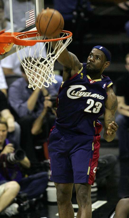 Cavaliers forward LeBron James (23) slam dunks during first half action in the NBA Finals Game 2 in San Antonio on June 10, 2007.