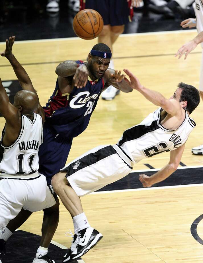 Spurs' guard Manu Ginobili (20) takes a charge from Cavaliers forward LeBron James (23) during first half action in the NBA Finals Game 1 in San Antonio on June 7, 2007.
